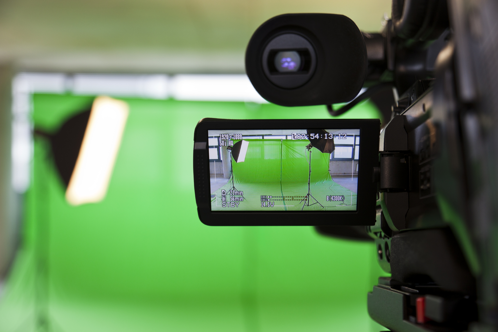 """Corporate Video Production Video Camera with a """"Green Screen"""" backdrop"""